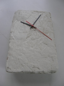 creation clock in white cement