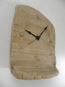creation clock in clay
