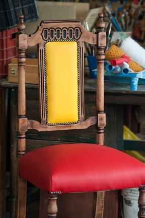 wooden chair with yellow and red leatherette