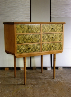 relooking of a chest of drawers. 50's with snake leatherette